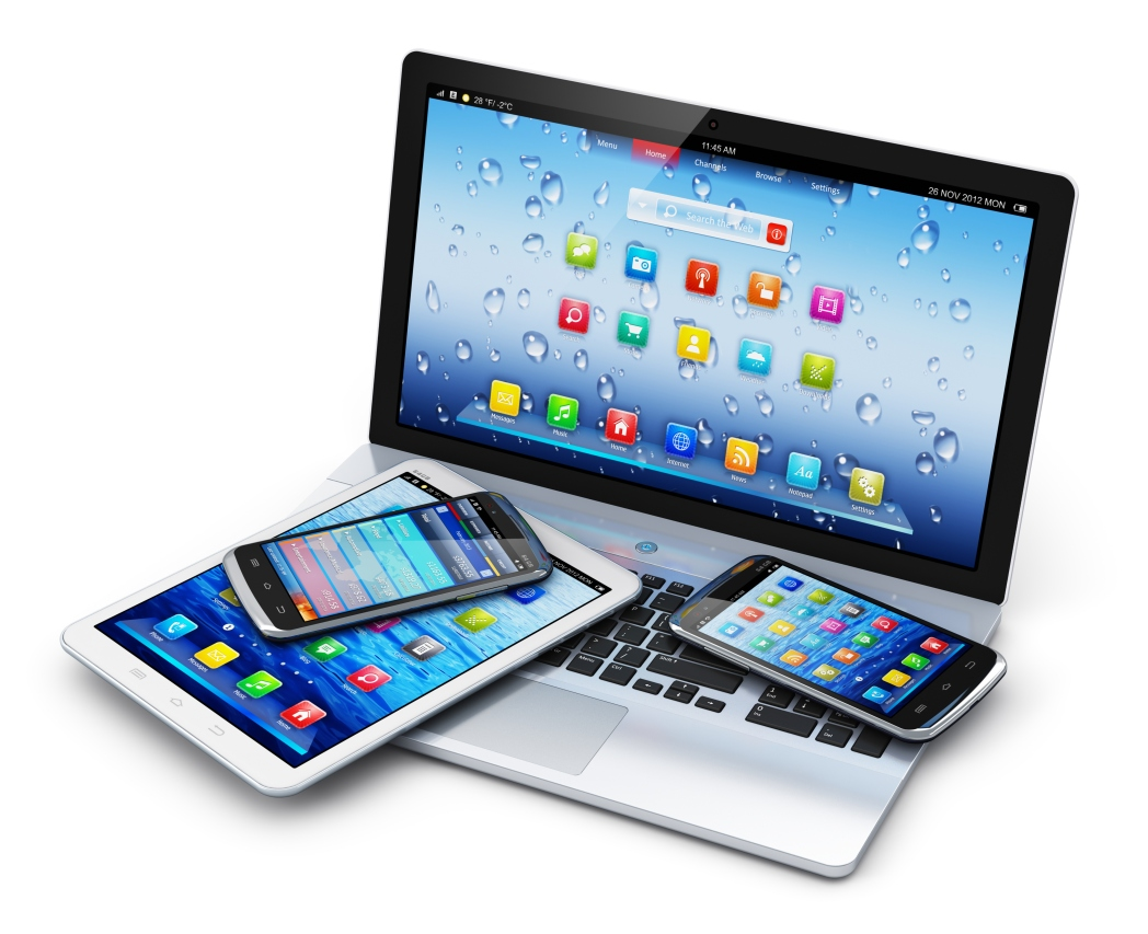 a table with a laptop, iphone and ipad