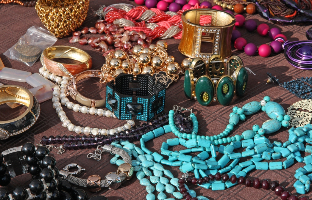 a table scattered with colourful jewellery