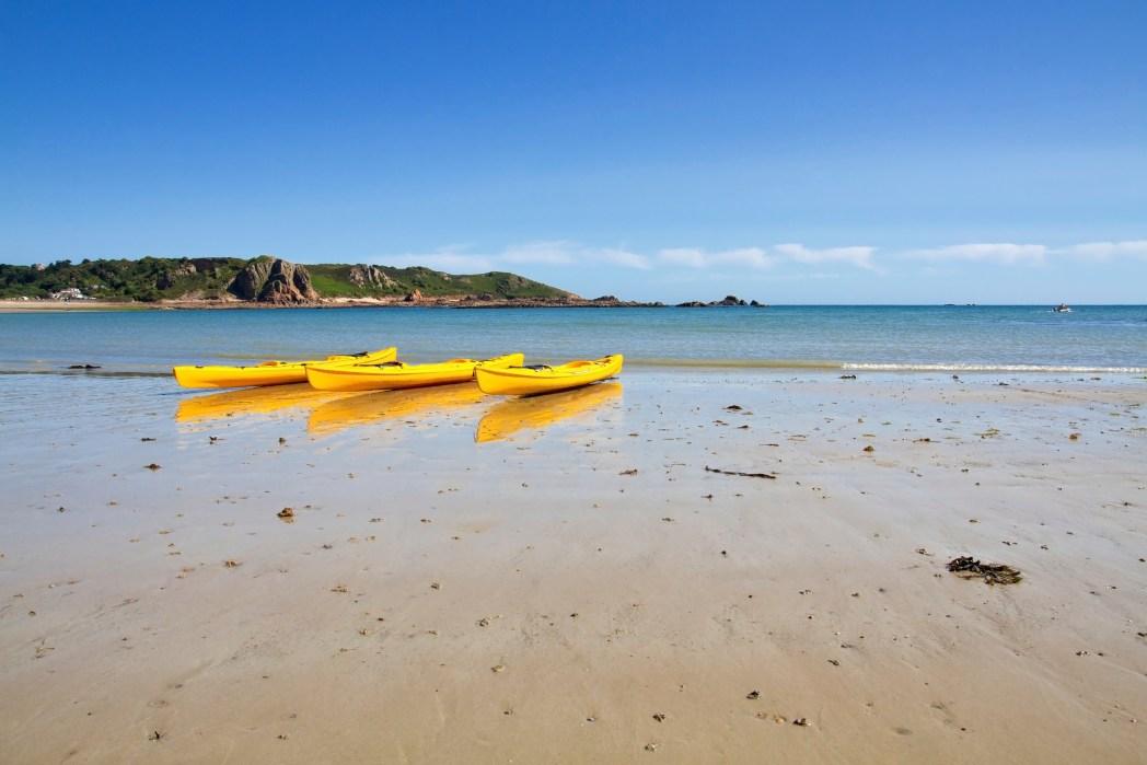 Three yellow boats on Jersey Island, England
