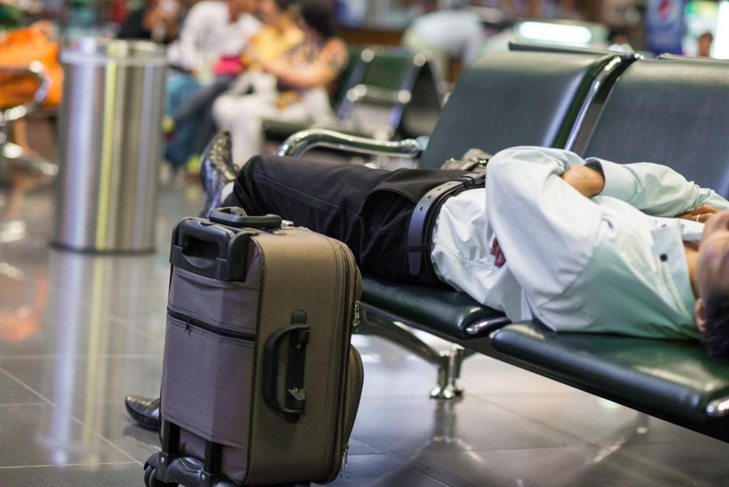 Delayed flight man sleeping at the airport