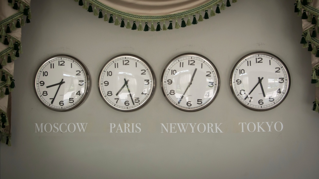 Four Clocks on a Wall Showing the Time in Moscow, Paris, New York and Tokyo