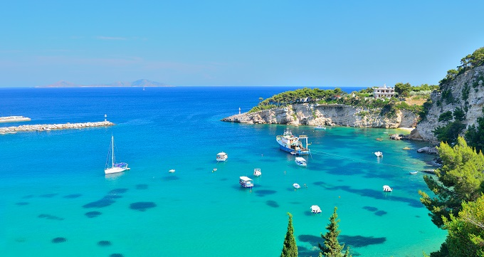 Alonissos, Greece, bots on the blue water, coastline.