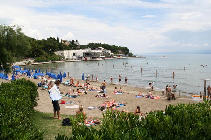 Bracvice Bay, people on the beach, blue umbrellas, Split, Croatia