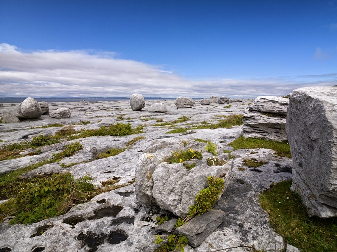 A scenic rocky patch under the blue sky at the Burren Way