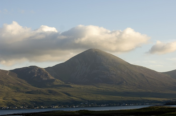 Croagh Patrick from a distance, crowned by a big white cloud