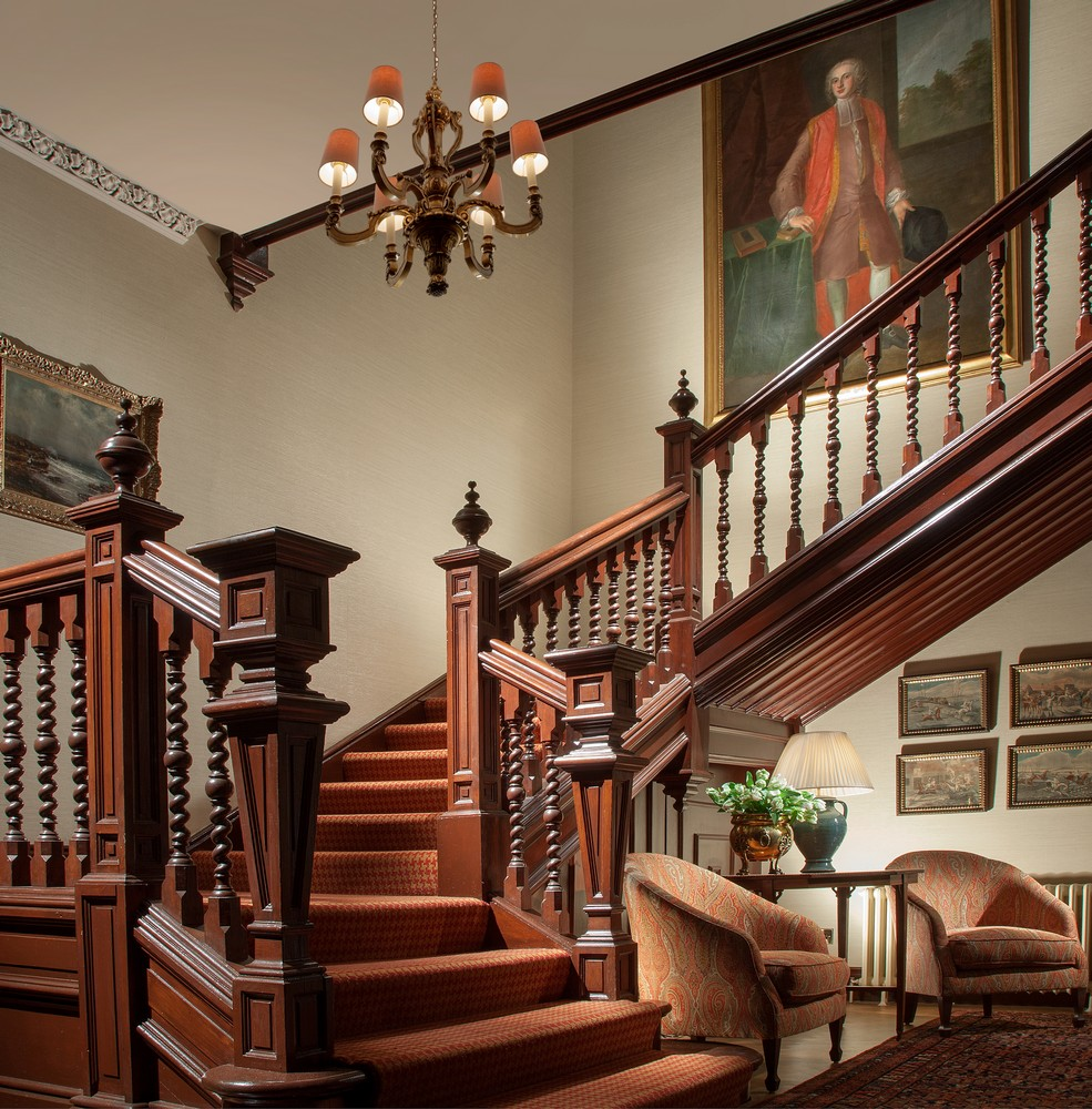 Historic wooden stairs with oil paintings at Cromlix hotel