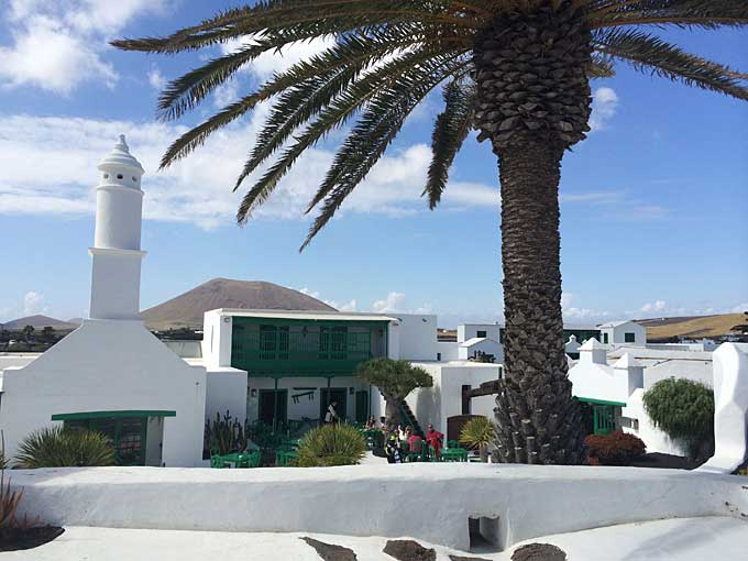 subtropical garden, palm trees, white-washed buildings, Lanzarote.