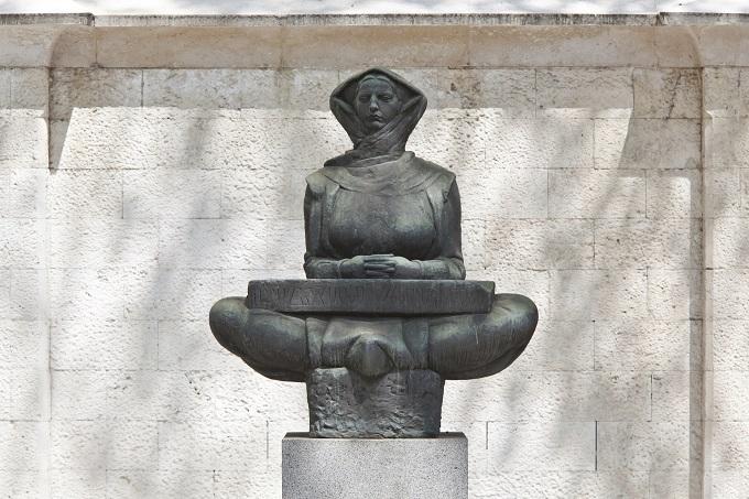 Mestrovic sculpture, woman with hood sitting crossed legs, Split, Croatia