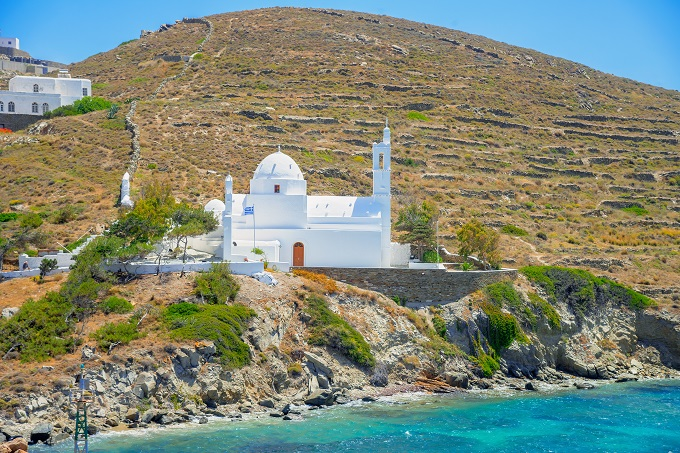 Paros, Greece, hillside, white church on hill above the sea.