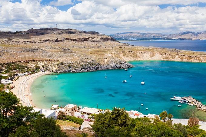 Rhodes, Greece, beach, dry brown land around it.