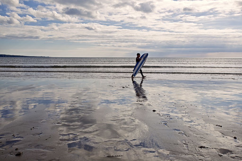 Surfing on Inch Strand, Kerry