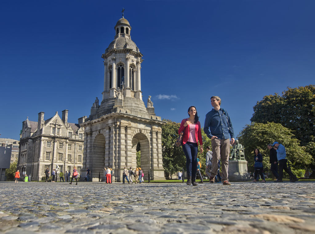 A couple walks in front of Trinity College Dublin, filming location for Ek the Tiger and Educating Rita. Credit: ©Brian Morrison / Tourism Ireland